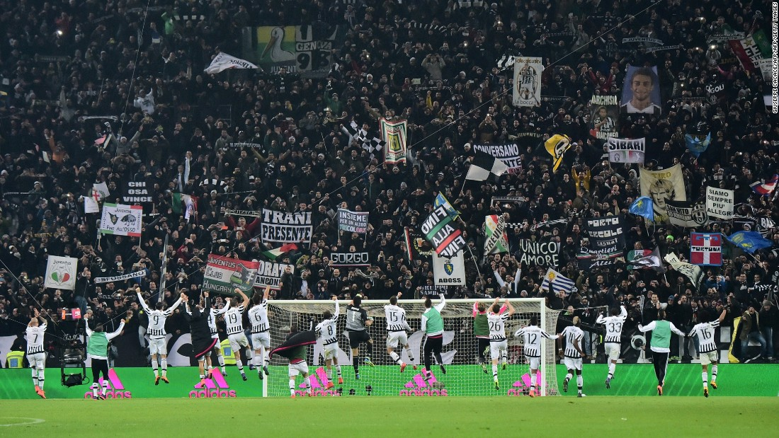 Juventus' players celebrate with fans at the end of the hard fought encounter.