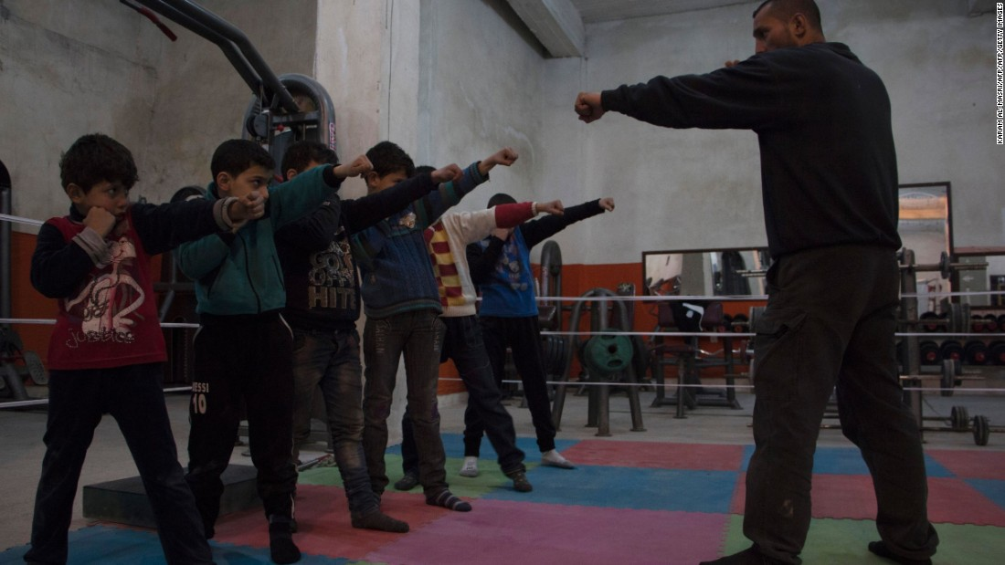 Boys line up and mimic Kattan, who became Syria's national champion only one year after taking up boxing professionally in 1994. Kattan opened the club with colleague Ahmad Mashallah to improve their form, and to give young fighters a chance to learn.