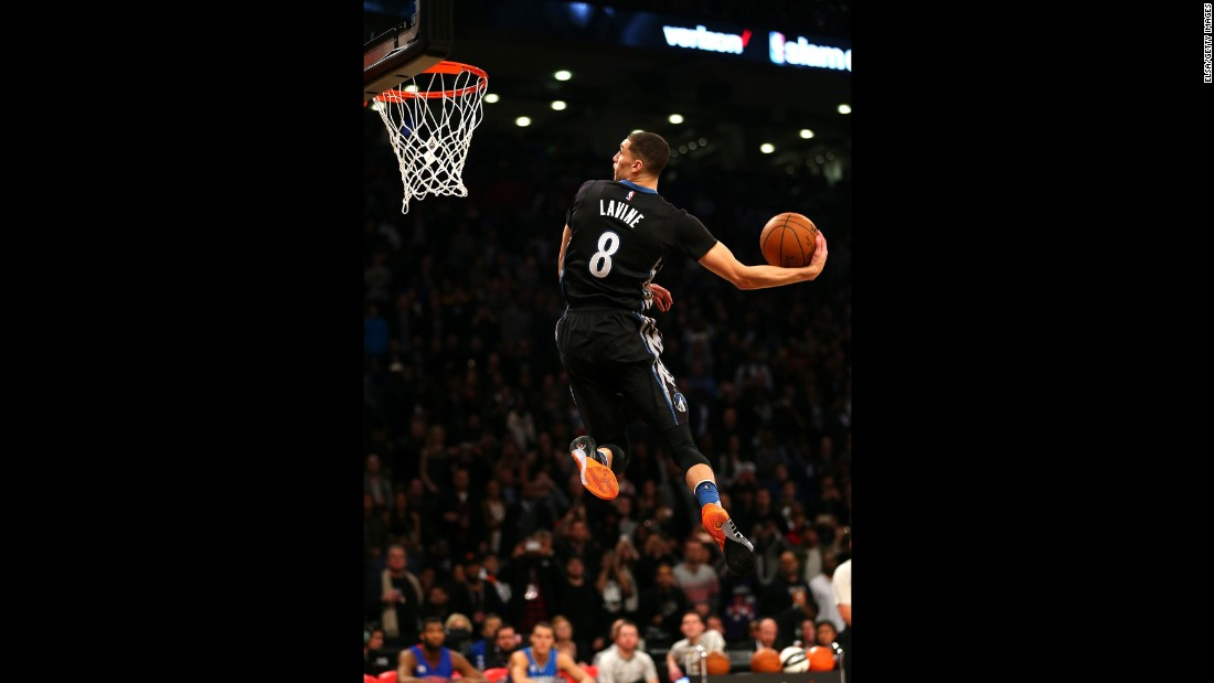 "LaVine won for the second straight year, topping Orlando's Aaron Gordon in one of the contest's best-ever duels. Gordon and LaVine traded perfect 50s throughout the final round, which had to be extended twice to break the tie. Gordon had the <a href=""https://www.youtube.com/watch?v=ig5EddENP_0"" target=""_blank"">more colorful dunks,</a> incorporating a mascot named Stuff the Magic Dragon. One dunk even involved Stuff spinning on a hoverboard. But in the end -- with both men having to go off script for extra dunks -- the judges favored LaVine, who went <a href=""https://www.youtube.com/watch?v=4x_HmGp5ibs"" target=""_blank"">between the legs</a> from just inside the free-throw line. Earlier in the competition, LaVine did a windmill from the free-throw line. He also caught an alleyoop pass while jumping from the line."