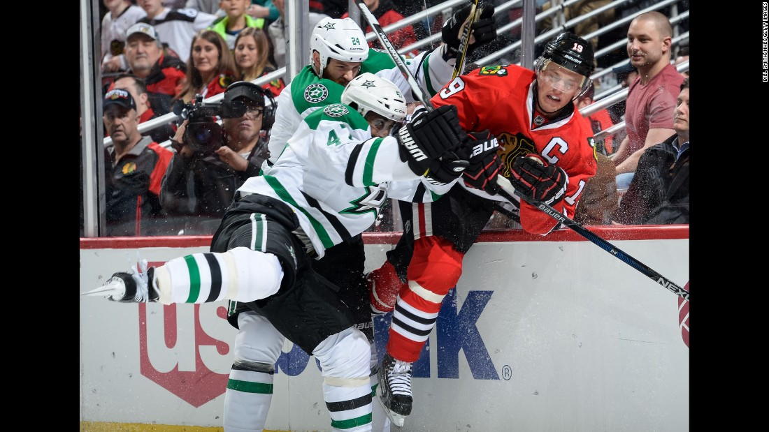 Chicago captain Jonathan Toews, right, is hit by Dallas' Johnny Oduya, center, and Jordie Benn during an NHL game in Chicago on Thursday, February 11. Oduya played the last four seasons with Toews in Chicago, winning two Stanley Cups.