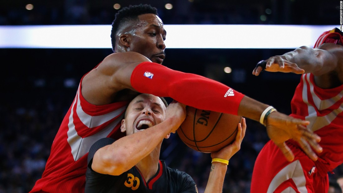 Houston's Dwight Howard fouls Golden State's Stephen Curry during an NBA game in Oakland, California, on Tuesday, February 9. The Warriors won 123-110 for their 42nd straight home victory. At the All-Star break, they had a record of 48-4 and were on pace to break the NBA record for wins in a regular season (72).