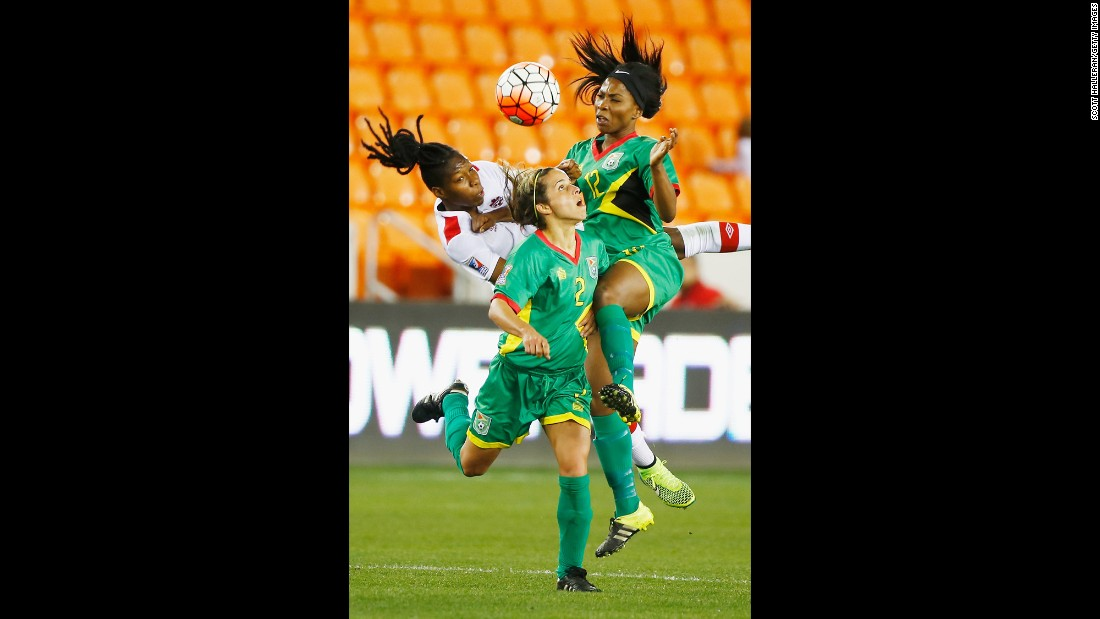 Canada's Kadeisha Buchanan, left, competes with Guyana players Alison Heydorn, center, and Otesha Charles during an Olympic qualifier in Houston on Thursday, February 11. Canada won 5-0.