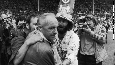 Bill Shankly receives the praise of jubilant Liverpool fans after defeating Leeds United in the 1974 Charity Shield match.