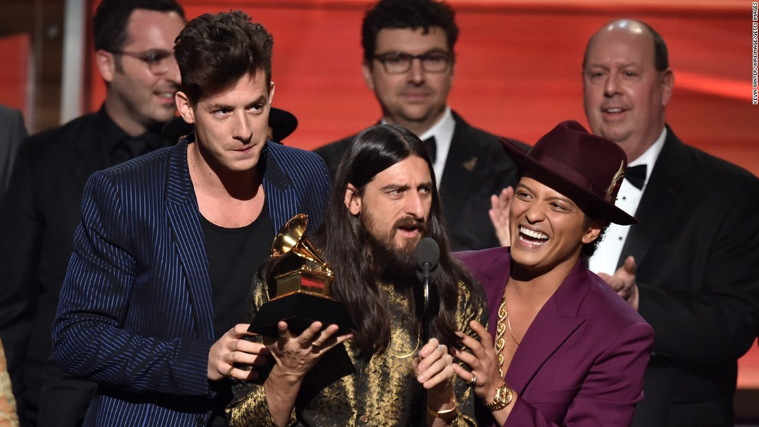 """Uptown Funk,"" Mark Ronson featuring Bruno Mars. Holding the Grammy between the two is producer Jeff Bhasker. The song also won the Grammy for best pop duo/group performance."