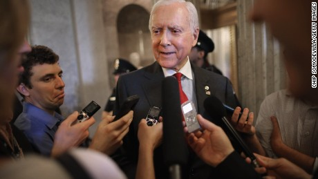 Sen. Orrin Hatch, a Utah Republicam talks with reporters after leaving the Senate floor at the US Capitol May 18, 2015 in Washington.