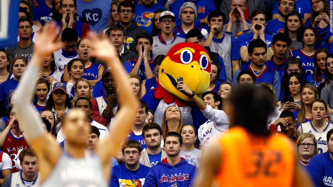 A Kansas basketball fan takes a selfie with the university's mascot, Big Jay, during a home game on Monday, February 15.