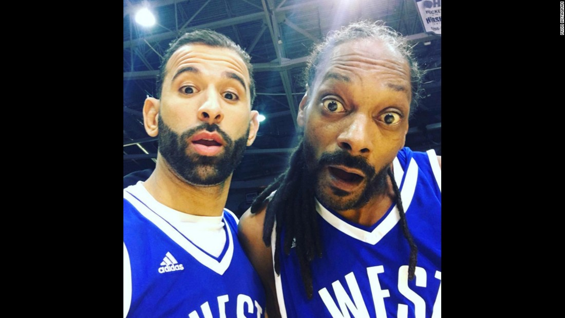 "Baseball star Jose Bautista, left, <a href=""https://www.instagram.com/p/BBvd96EGmHi/"" target=""_blank"">takes a selfie with rapper Snoop Dogg</a> at a charity basketball game in Toronto on Saturday, February 13."