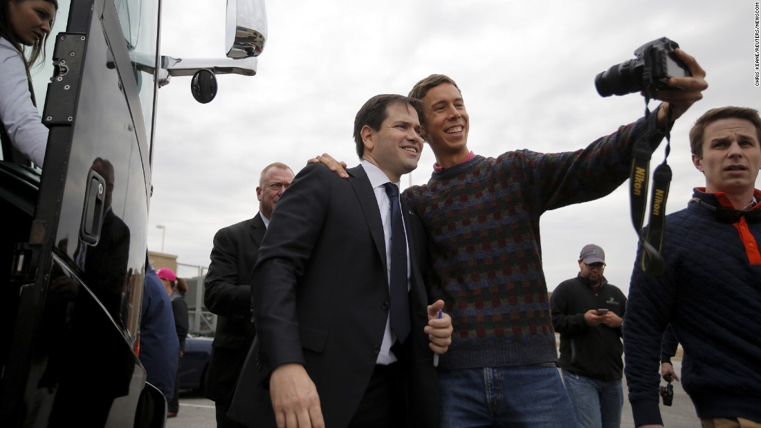 U.S. Sen. Marco Rubio, a Republican presidential candidate, poses for a supporter's selfie after a town-hall event in Easley, South Carolina, on Sunday, February 14.