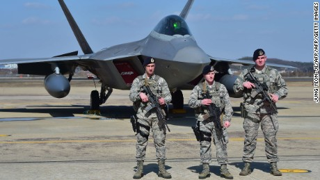 US troops stand guard near a US F-22 stealth fighter at the Osan Air Base in Pyeongtaek, south of Seoul, on Wednesday.