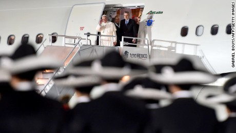Pope Francis waves after his Alitalia flight -- which the airlines says was hit by a laser moments earlier -- touched down last Friday in Mexico City.
