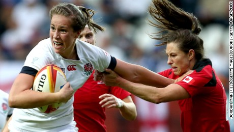 PARIS, FRANCE - AUGUST 17:  Emily Scarratt of England breaks free from a tackle by Brittany Waters of Canada during the IRB Women's Rugby World Cup 2014 Final between England and Canada at Stade Jean-Bouin on August 17, 2014 in Paris, France.  (Photo by Jordan Mansfield/Getty Images)