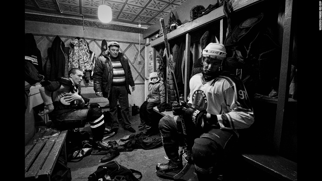 Players of HC Vetluga, an amateur hockey team in Vetluga, Russia, sit in a locker room on February 19. Pesnya photographed the team before, during and after a regional championship game.