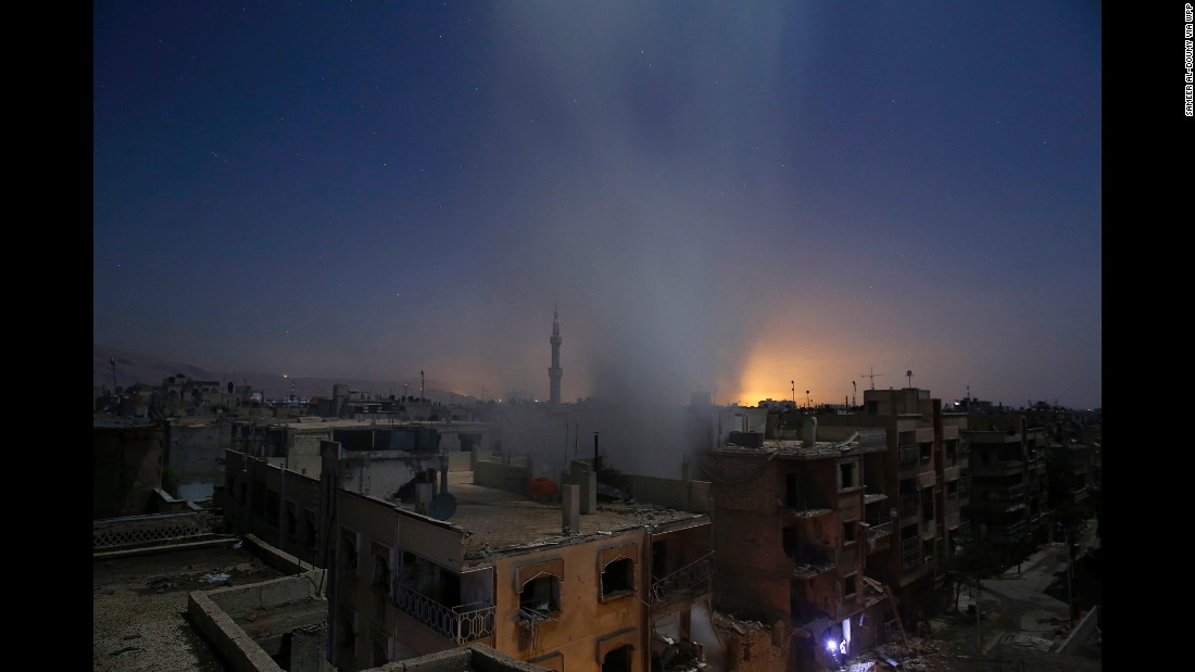 Smoke rises from a building in Douma, Syria, following reported shelling by Syrian government forces on October 30. This series of photos focuses on Douma, a rebel-held city that has been subjected to massive aerial bombardment.