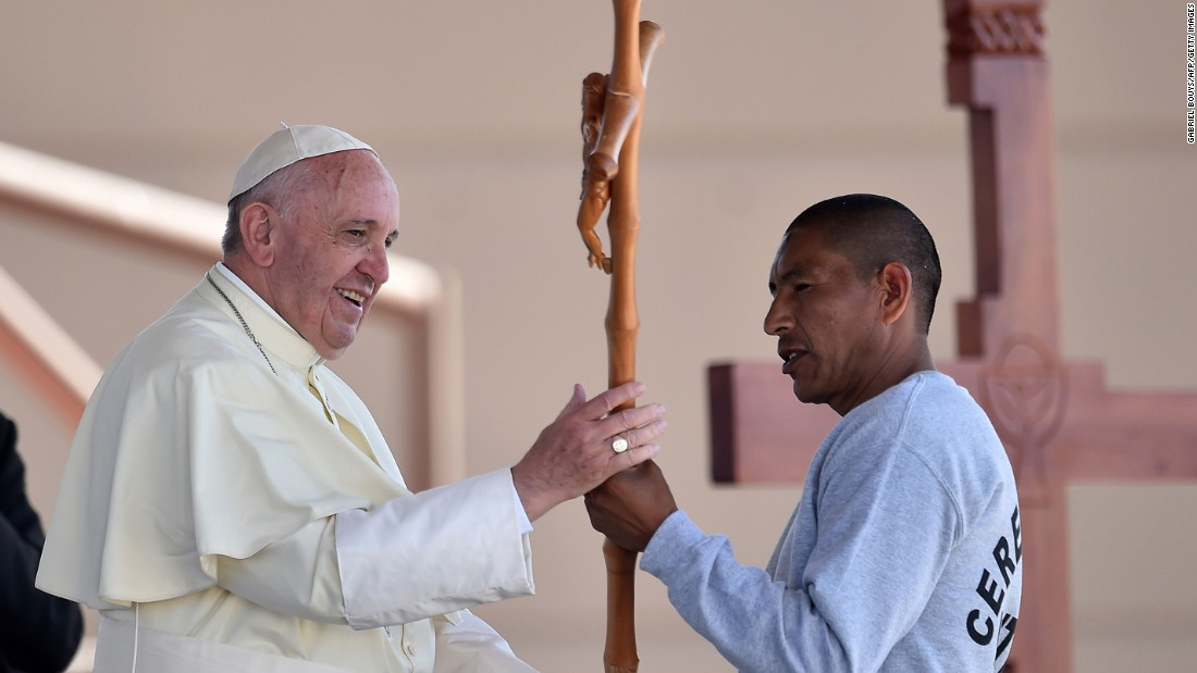 Pope Francis receives a cross made by an inmate at a prison in Ciudad Juarez on February 17.
