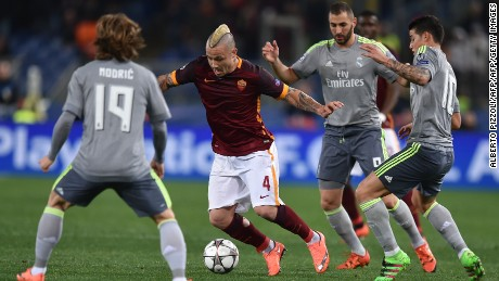 Roma's Nainggolan (C) fights for the ball against Real Madrid.