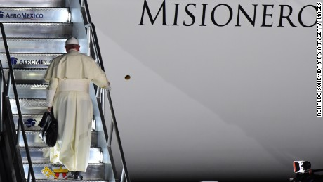 Pope Francis boards a plane for Rome at the airport in Ciudad Juarez, Chihuahua state, Mexico, on February 17, 2016. Throngs gathered at Mexico's border with the United States on Wednesday for a huge mass with Pope Francis highlighting the plight of migrants -- a hot-button issue on the US presidential campaign trail.  AFP PHOTO/ RONALDO SCHEMIDT / AFP / RONALDO SCHEMIDT        (Photo credit should read RONALDO SCHEMIDT/AFP/Getty Images)
