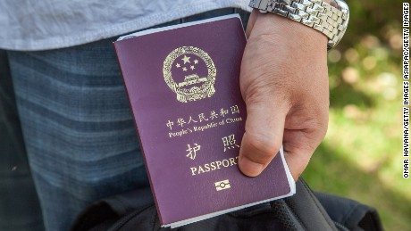 BAVET, CAMBODIA - MAY 16:  A Chinese national holds a Chinese Passport after being stamped to enter Cambodia after fleeing Vietnam on May 16, 2014 at the Bavet border crossing, Cambodia. More than a thousand Chinese nationals have fled Vietnam over the past few days, crossing into Cambodia at the Bavet border crossing, in order to escape violent protests which have erupted in Vietnam over the South Sea conflict. Riots against Chinese companies started last Wednesday in different parts of the country. The riots come in the wake of violent attacks on factories in Vietnam's south, amid international outcry over the placement of an oil rig by China in an area of the South China sea that is currently claimed by both countries. (Photo by Omar Havana/Getty Images)