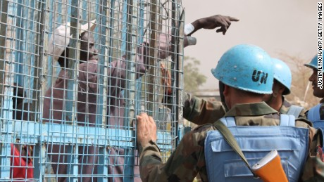 A South Sudanese civilian speaks with UN peacekeepers at the United Nations base in the northeastern town of Malakal as clashes continued there Thursday.