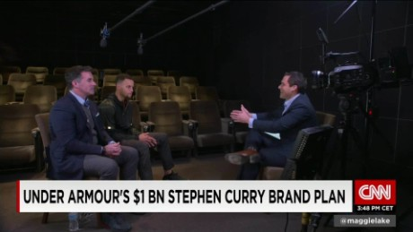 Andy Scholes talks with Kevin Plank & Steph Curry_00011930.jpg