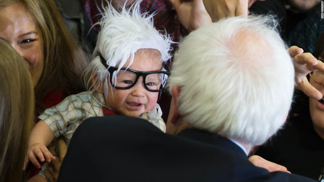 U.S. Sen. Bernie Sanders meets a 3-month-old dressed like him at a campaign rally in Las Vegas on Sunday, February 14. Sanders is seeking the Democratic Party's nomination for President.