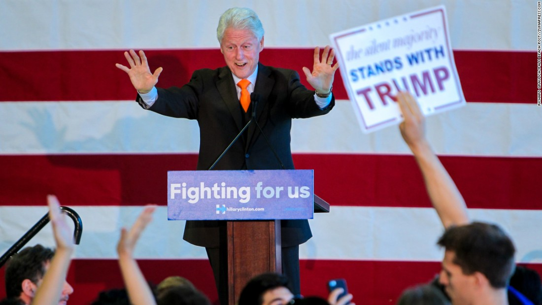 "A Donald Trump supporter holds up a sign as former U.S. President Bill Clinton stumps for his wife in Riviera Beach, Florida, on Monday, February 15. The Trump supporter yelled to Clinton, ""You took his money!"" meaning Trump. ""I certainly did,"" Clinton responded. ""I took his money for my foundation, where I used it better than he's using it now."""
