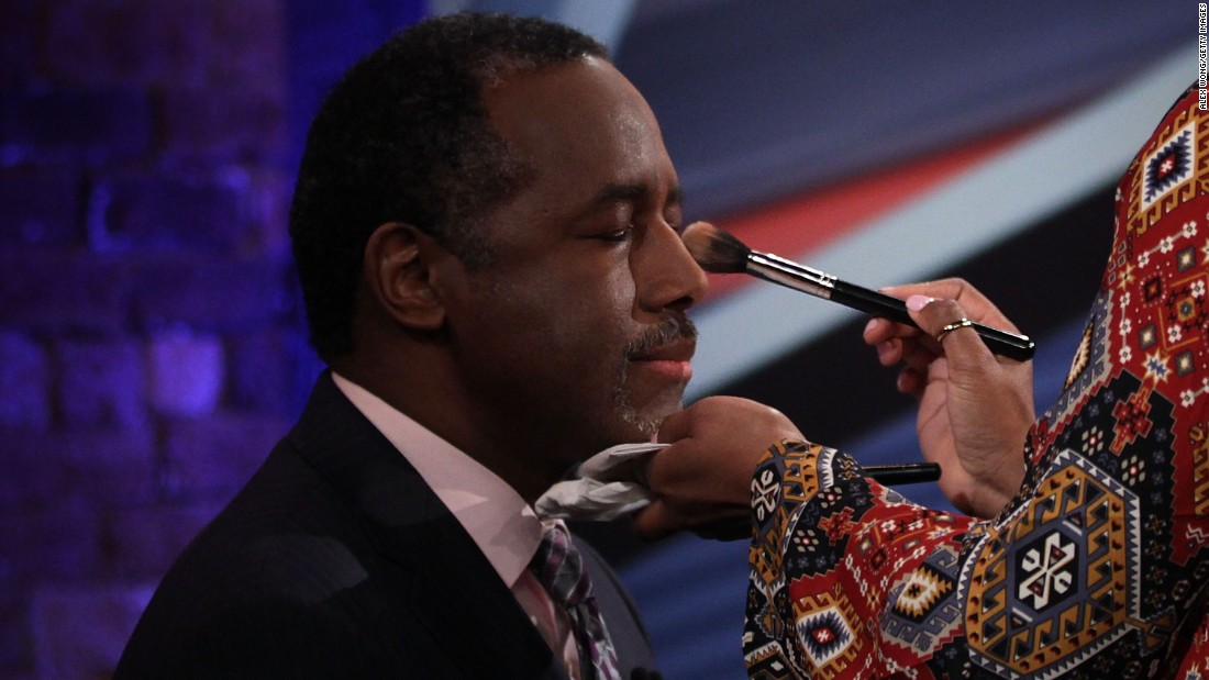 Republican presidential candidate Ben Carson has makeup applied during a commercial break of the CNN town-hall event held Wednesday, February 17, in Greenville, South Carolina.