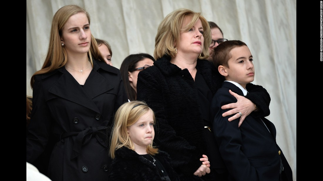 Family members watch as Scalia's casket is carried up the steps of the Supreme Court building on February 19.