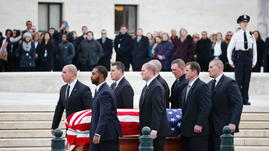 Pallbearers carry Scalia's casket on February 19.