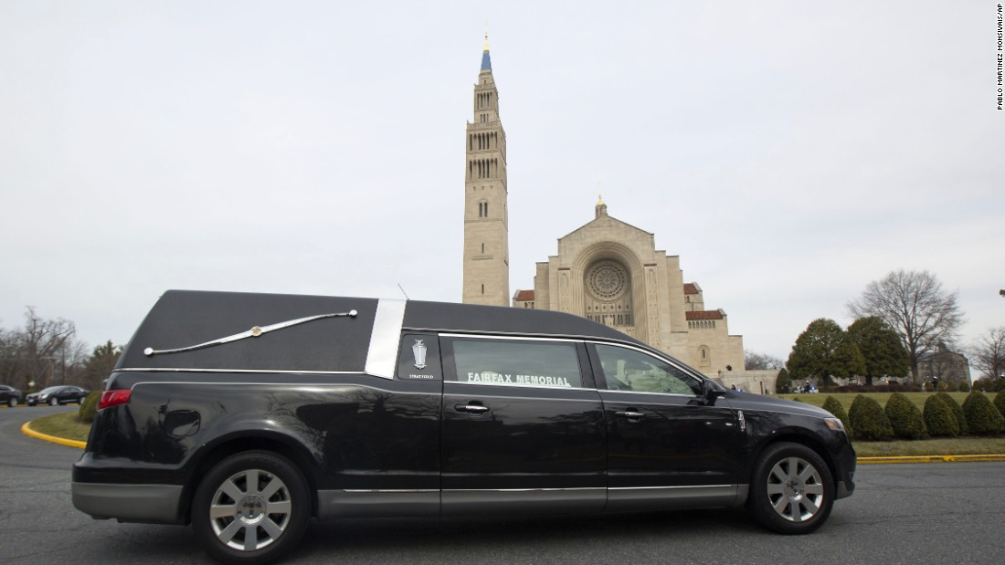 The hearse carrying Scalia's casket arrives at the Basilica of the National Shrine of the Immaculate Conception in Washington on February 20.