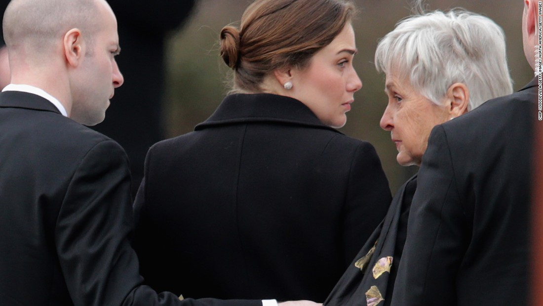 Maureen Scalia, right, arrives for the funeral for her husband on February 20.
