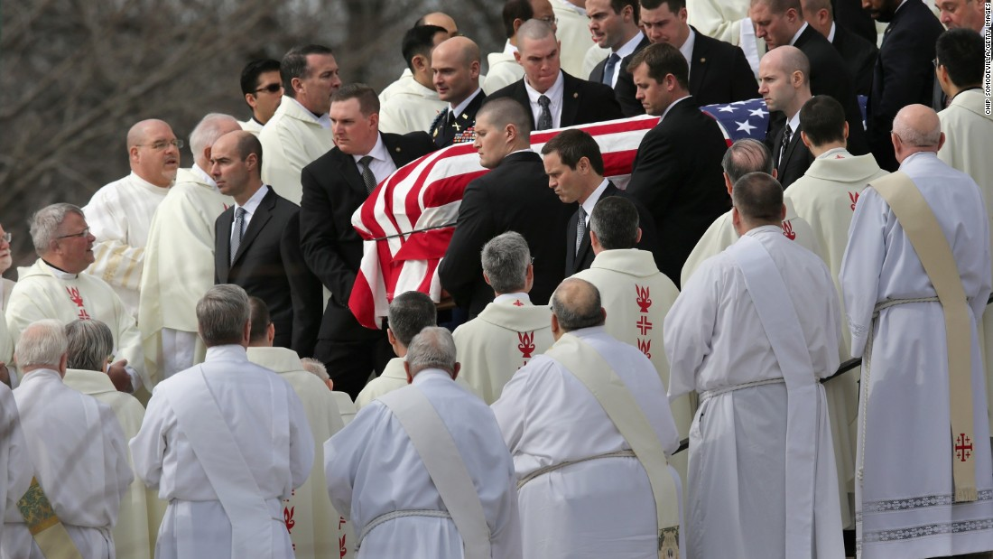U.S. Supreme Court Police pallbearers carry Associate Justice Antonin Scalia's flag-covered casket between rows of Catholic clergy and out of the Basilica of the National Shrine of the Immaculate Conception after his funeral on Saturday, February 20, in Washington.