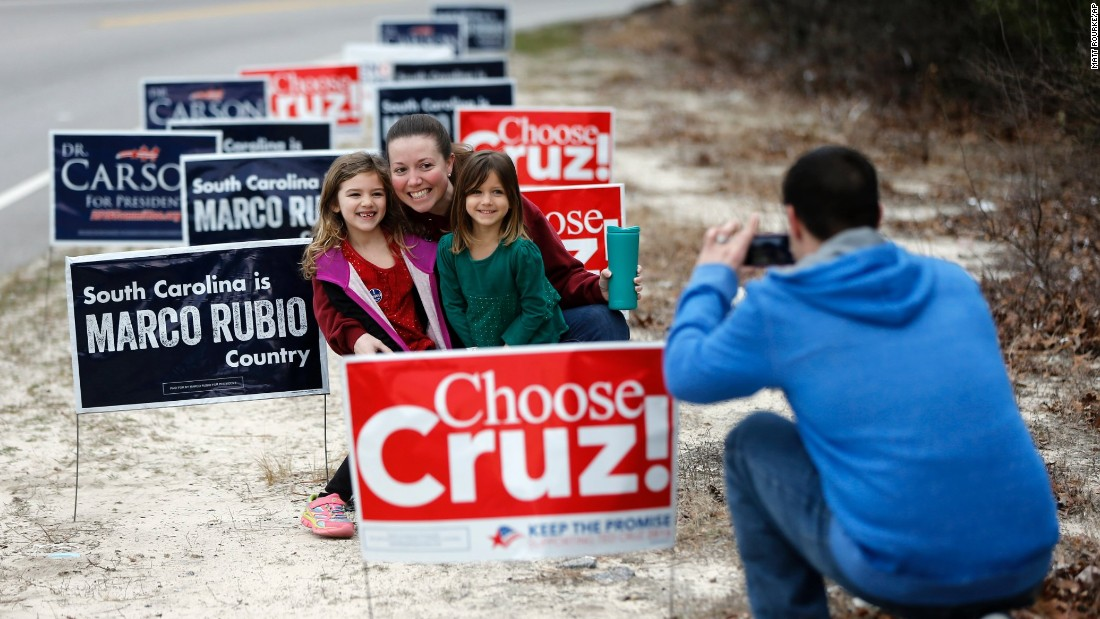 John Mew  photographs his wife Amy, and daughters Ireland, 6, left, and Sailor, 4, after voting in the South Carolina Republican presidential primary Saturday, February 20 at Emmanuel Lutheran Church in West Columbia, South Carolina.