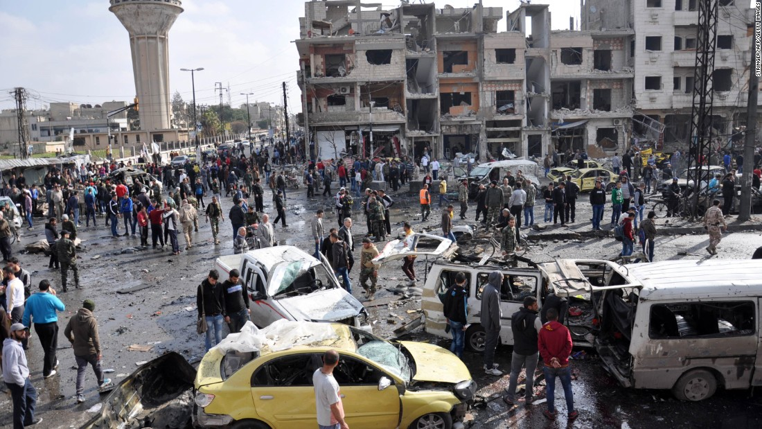 "Syrians gather at the site of a double car bomb attack in the Al-Zahraa neighborhood of the Homs, Syria, on February 21, 2016. <a href=""http://www.cnn.com/2016/02/21/middleeast/syria-civil-war/index.html"" target=""_blank"">Multiple attacks in Homs and southern Damascus</a> kill at least 122 and injure scores, according to the state-run SANA news agency. ISIS claimed responsibility."
