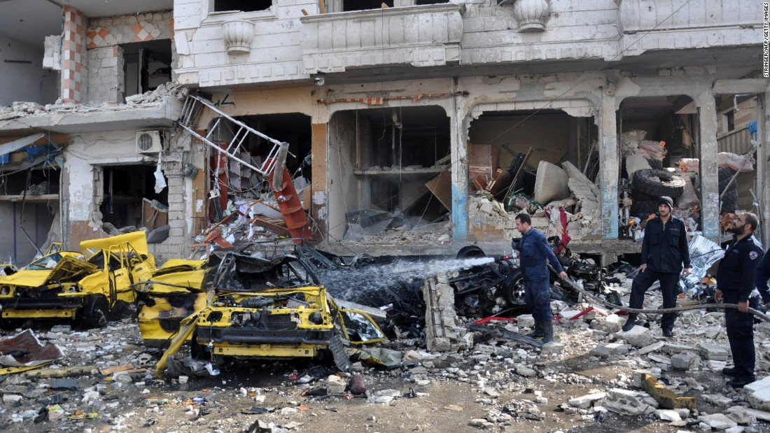 In Syria, dozens killed as bombers strike in Homs and Damascus, regime says