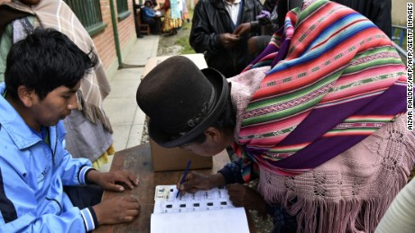 An Aymara indigenous woman places her signature after voting on February 21, 2016 in Huarina, 75 km from La Paz, Bolivia in a referendum on a constitutional reform that would allow Evo Morales to seek a fourth term as president, potentially extending his stay in office until 2025. Morales, Bolivia's first indigenous president, was first elected to office in 2006 and re-elected twice. His current term ends in 2020. AFP PHOTO/Aizar Raldes / AFP / AIZAR RALDES        (Photo credit should read AIZAR RALDES/AFP/Getty Images)