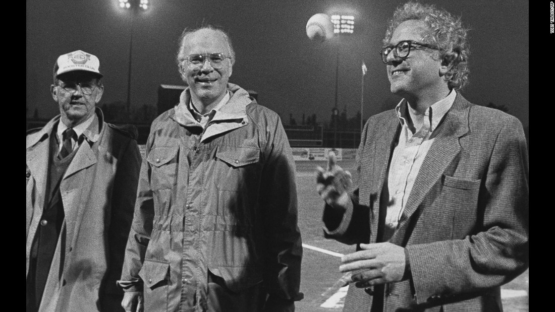 Sanders, right, tosses a baseball before a minor-league game in Vermont in 1984. U.S. Sen. Patrick Leahy, center, was also on hand.