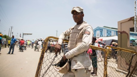 A Dominican soldier stands guard near the Dominican-Haitian border.