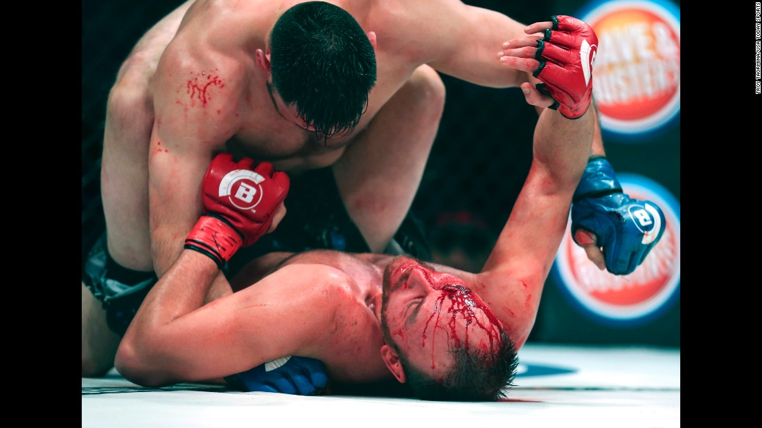 C.J. Hancock, bottom, tries to hold off Ruben Esparza during their Bellator bout in Houston on Friday, February 19. Hancock would win the fight with a rear-naked choke in the third round.