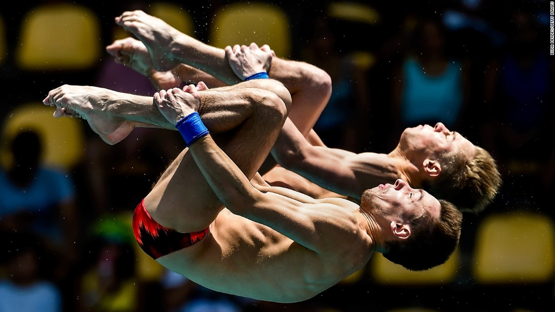 Victor Minibaev, left, and Roman Izmailov perform synchronized dives at the Diving World Cup on Saturday, February 20. The Russians finished fifth in the 10-meter platform.