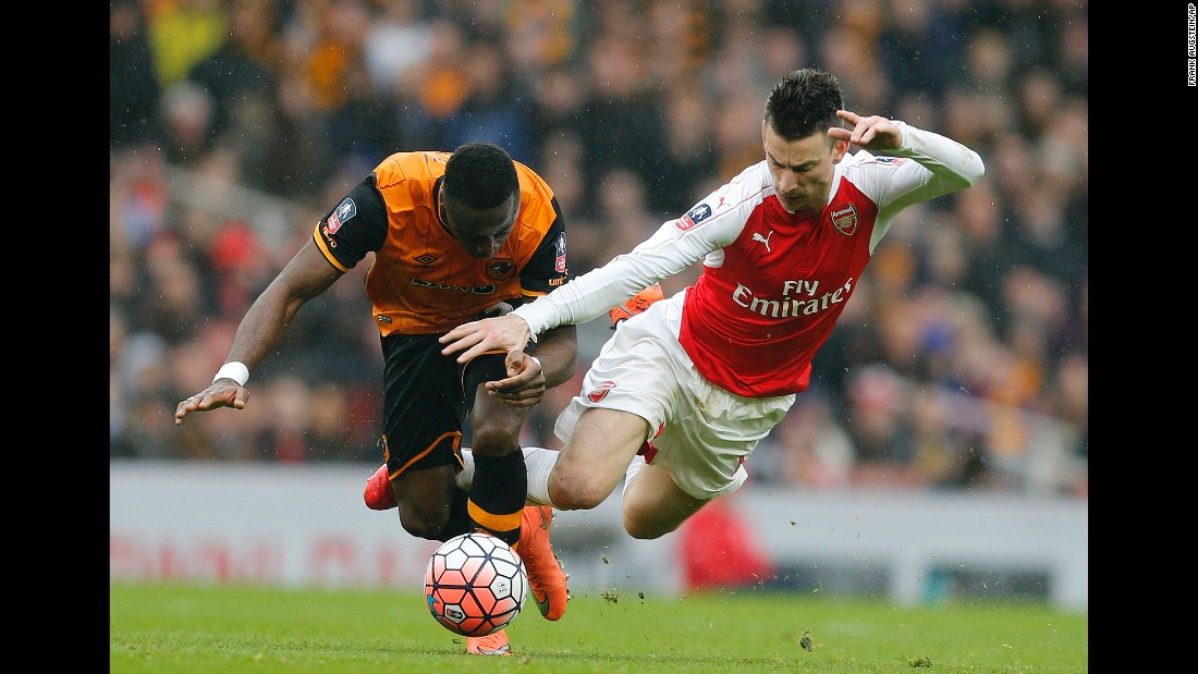 Hull City's Adama Diomande, left, competes for the ball with Arsenal's Laurent Koscielny during an FA Cup match in London on Saturday, February 20. The match ended scoreless.