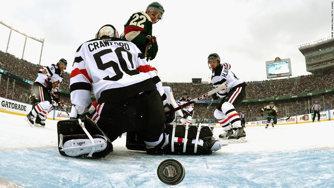 The puck gets past Chicago goalie Corey Crawford during an NHL game in Minneapolis on Sunday, February 21. The game was played at the University of Minnesota's football stadium as part of the league's Stadium Series. The home team Wild won 6-1.