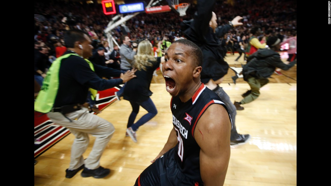 Texas Tech basketball player Toddrick Gotcher runs toward fans as they celebrate the team's home win over No. 3 Oklahoma on Wednesday, February 17.