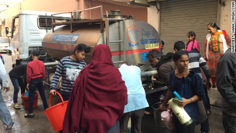 Residents collect water from a tanker in West Delhi.