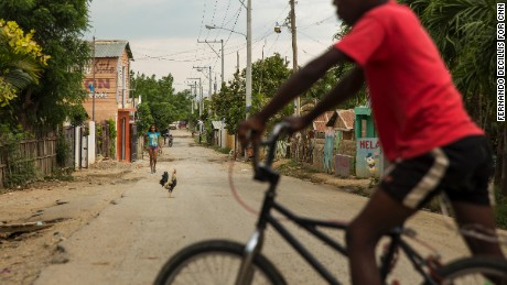 A Dominican boy of Haitian descent rides his bike in Esperanza, Dominican Republic, in July 2015. Dominicans in this segment of the population are fighting for equal rights.