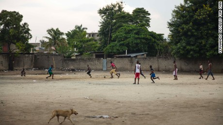 Children play soccer in a dirt lot in Ouanaminthe, Haiti.