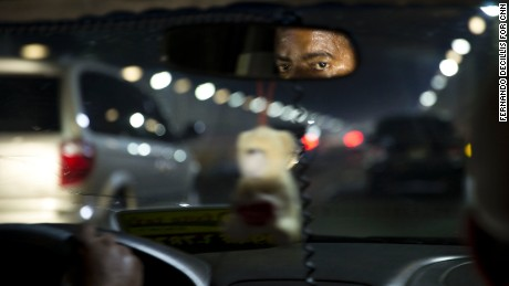 A Dominican taxi driver contends with Santo Domingo traffic. Immigration seemed to be on everyone's mind.