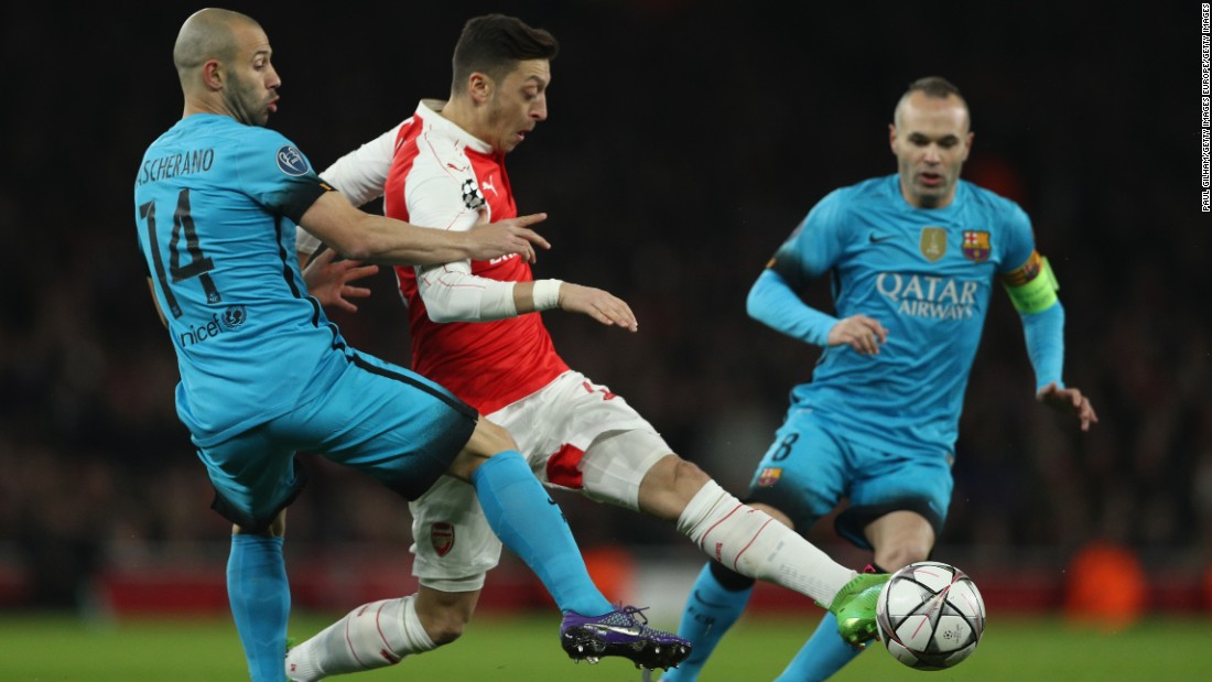 Arsenal, second in the English Premier League, started well with Mesut Ozil finding space against the Catalan club.