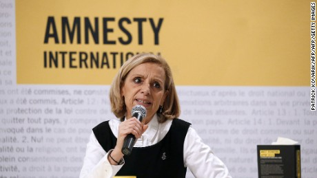 President of Amnesty International Genevieve Garrigos delivers a press conference in Paris on February 23, 2016. / AFP / PATRICK KOVARIK        (Photo credit should read PATRICK KOVARIK/AFP/Getty Images)