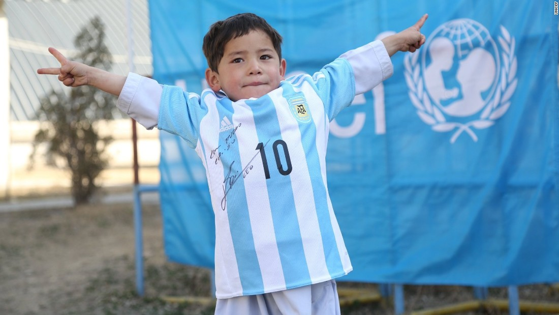 Murtaza wears the autographed Lionel Messi Argentina shirt given to him by the soccer superstar and UNICEF. He had been pictured in his native Afghanistan wearing a striped plastic bag with the star's name and number written on it to replicate a shirt.