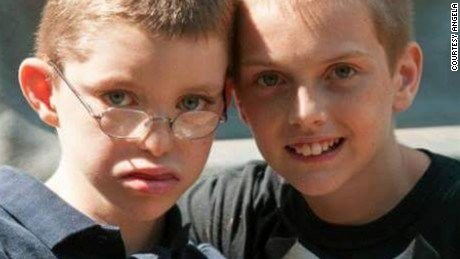 Jacob, left, with his older brother John, in 2013. Jacob has a rare disease discovered by an online gene matchmaker service that researchers are developing.